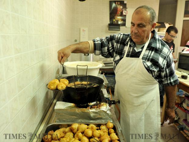 A man prepares zeppoli fritters at the feast of St Joseph in Rabat on March 19. Photo: Chris Sant Fournier