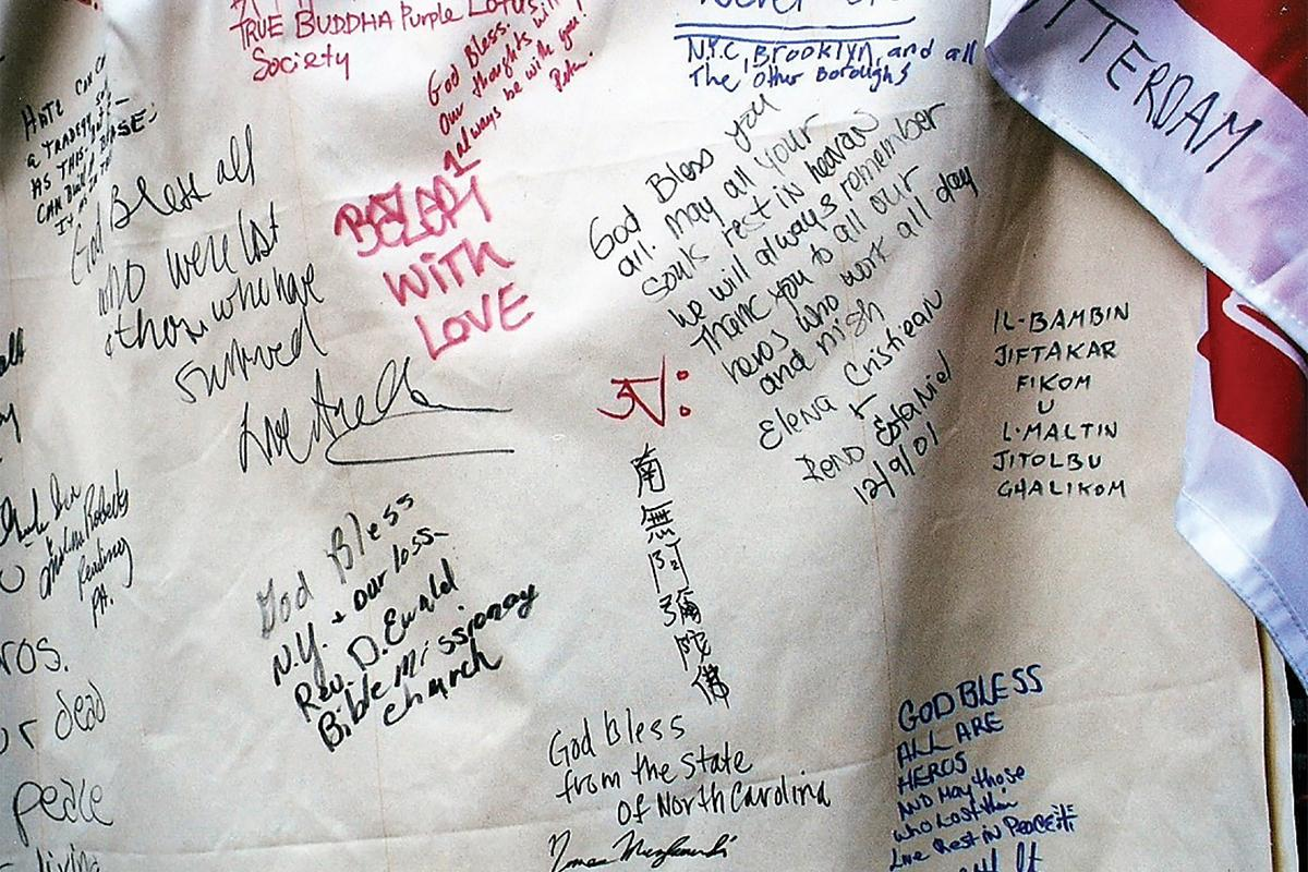 A tarpaulin at Ground Zero with Fr Julian's message in Maltese (right).