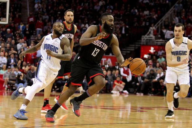 Houston Rockets guard James Harden (13) dribbles the ball against the Orlando Magic during the fourth quarter at Toyota Center. Photo: Erik Williams-USA TODAY Sports