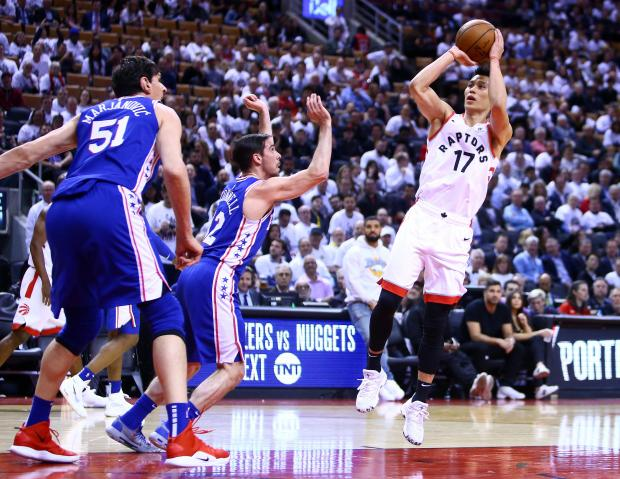 Jeremy Lin (right) of the Toronto Raptors shoots the ball as T.J. McConnell (left) of the Philadelphia 76ers defends in the second half during Game Five.