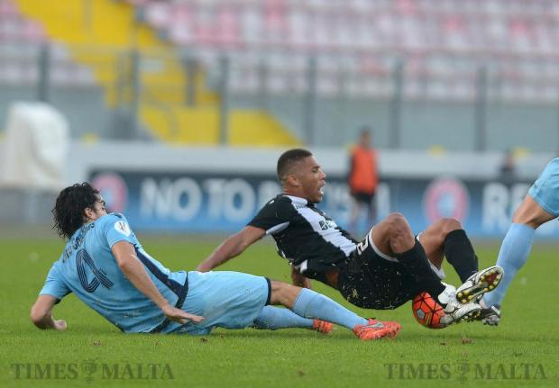 Hibernians' Jurgen Da Silva Perreira tries to control the ball on the floor after being tackled by Sliema Wanderers' Matias Muchardi during their BOV Premier League match at The National Stadium in Ta'Qali on November 26. Photo: Matthew Mirabelli