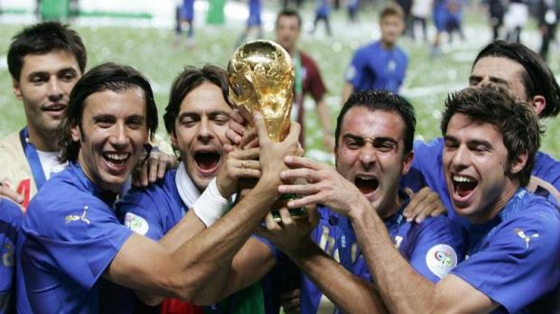 Cristian Zaccardo (left) holds the World Cup trophy after their victory in the 2006 final in Berlin.