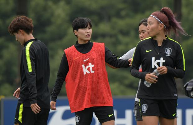 South Korea's forward Ji So-yun (centre) and her teammates attend a training session.