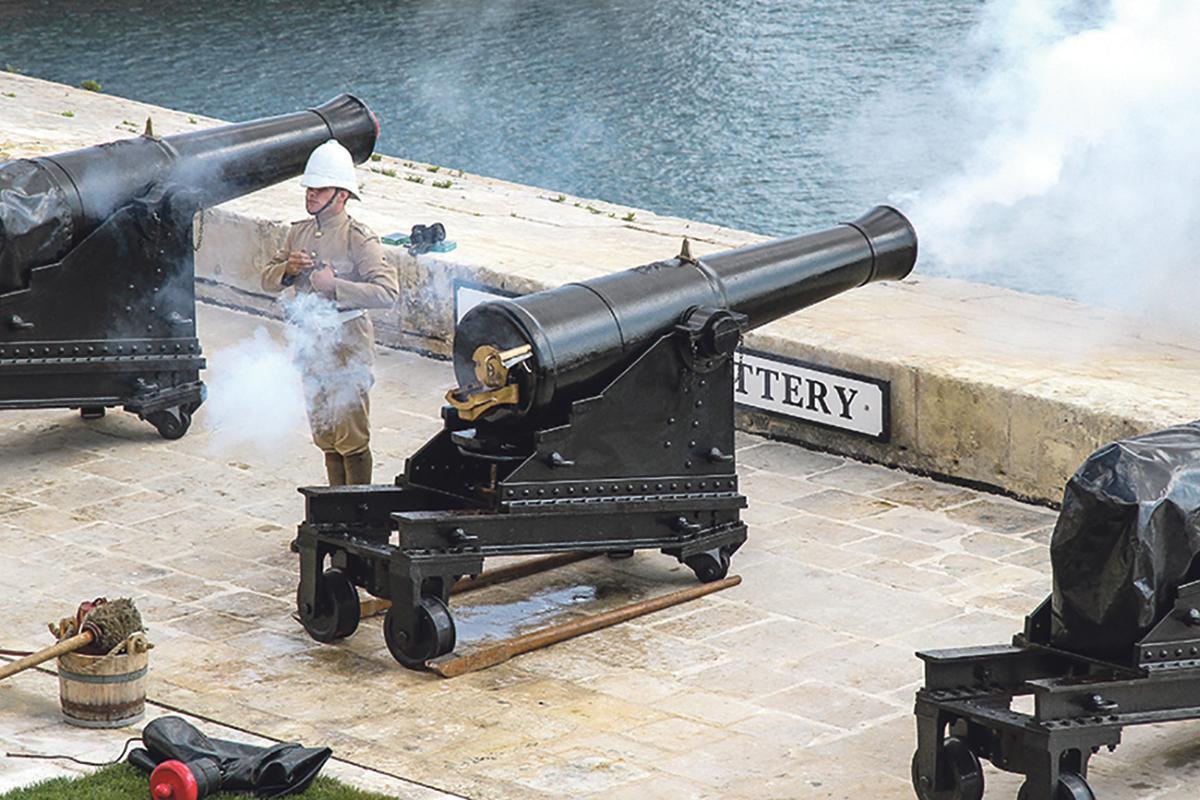 Firing of the noon-day gun from the Upper Barrakka Saluting Battery, Valletta.