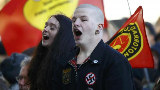 Opponents of anti-immigration right-wing movement Pegida protest in Cologne.