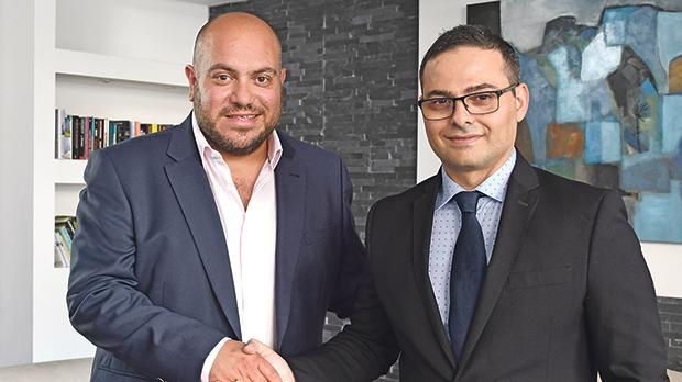 Ozone chief commercial officer Adrian Sillato with Massimo Pappalardo, sales manager, Grenke Malta, at The George Hotel, St Julian's.