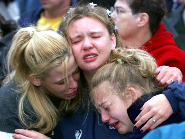 Three students weep with grief in this file photo from the 1999 shooting. Photo: AFP