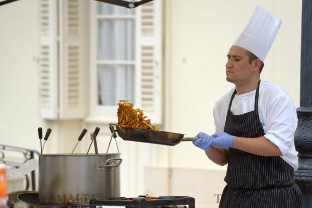 A chef cooks some pasta during the Fish Festival in Zurrieq on June 5. Photo: Matthew Mirabelli