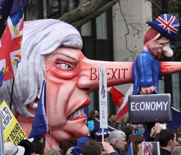 Protesters say Theresa May's government has misled the nation. Photo: AFP