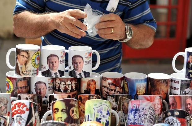 Mugs depicting Maltese politicians and other personalities are sold on a Valletta stall on April 20. Photo: Chris Sant Fournier
