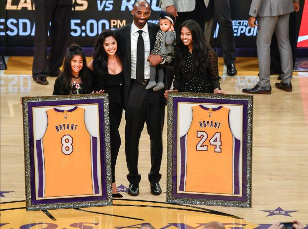 Former Lakers player Kobe Bryant (C) and family pose for a photo during a halftime ceremony to retire the two uniform at Staples Center. Photo: Robert Hanashiro-USA TODAY Sports