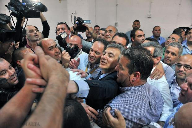 Nationalist Party leader Simon Busuttil and deputies Mario de Marco and Beppe Fenech Adami are given an enthusiastic welcome by party supporters at the Naxxar counting hall on April 18. Photo: Jason Borg