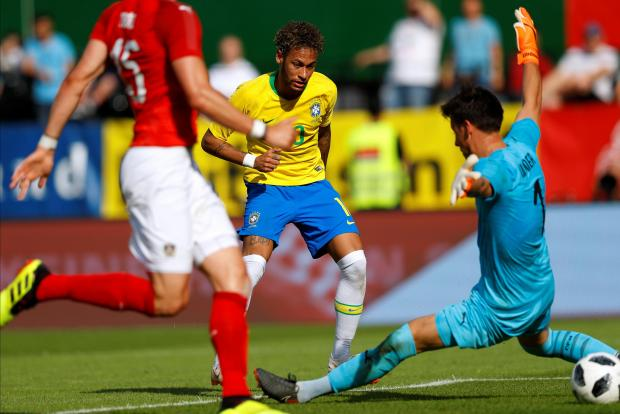 Brazil's Neymar scores their second goal.