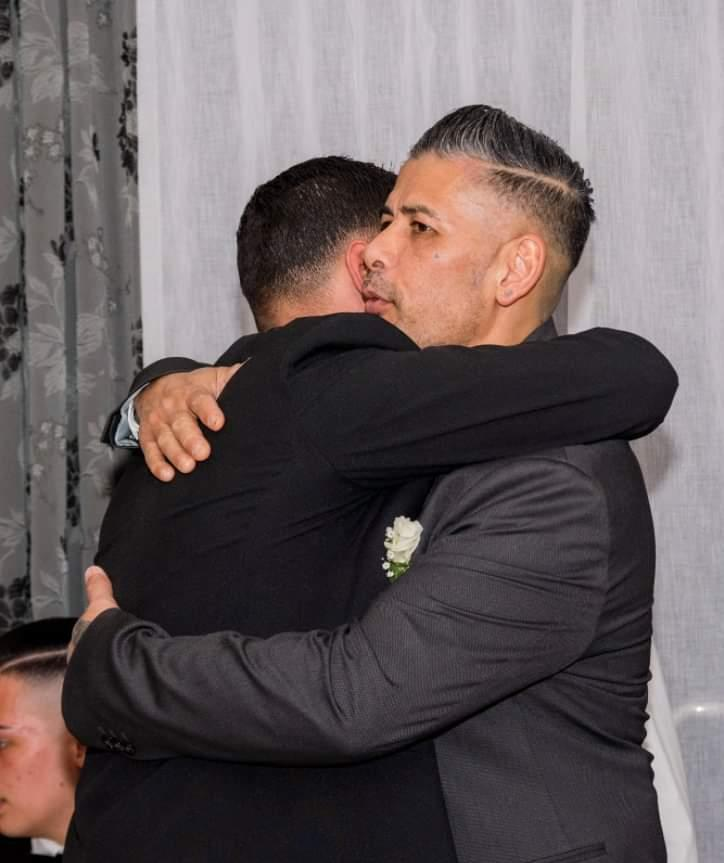 Bruce hugging his father Jesmond