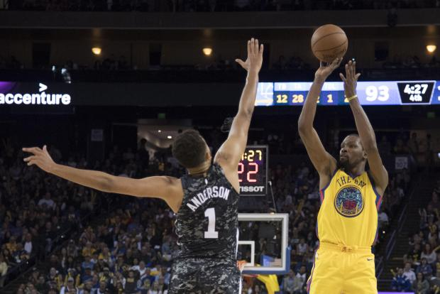 Golden State Warriors forward Kevin Durant (35) shoots the basketball against San Antonio Spurs forward Kyle Anderson (1) during the fourth quarter at Oracle Arena. The Warriors defeated the Spurs 110-107. Photo Credit: Kyle Terada-USA TODAY Sports