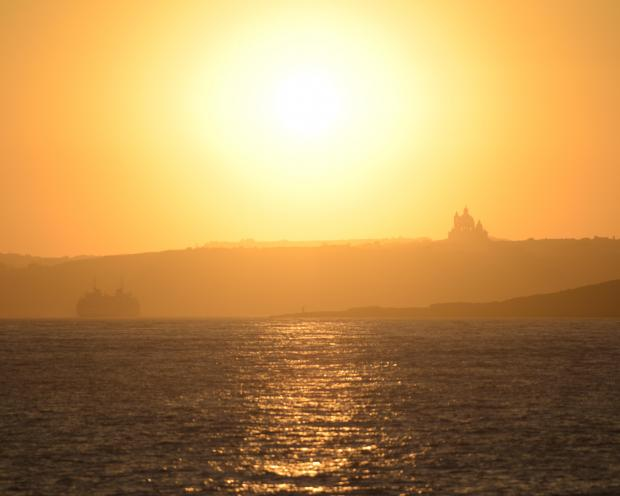 The sun sets over Gozo shading the Gozo Channel on July 14. Photo: Mark Zammit Cordina