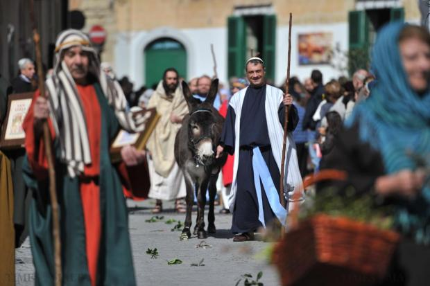A donkey accompanies Balzan residents dressed up in period costume to commemorate Palm Sunday on March 29. Photo: Jason Borg
