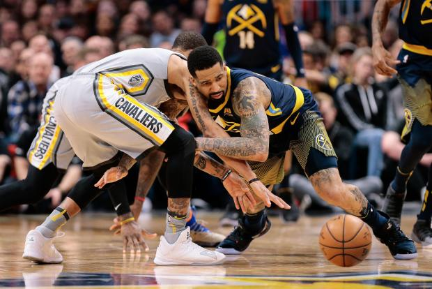 Cleveland Cavaliers guard George Hill (3) and Denver Nuggets forward Wilson Chandler (21) battle for a loose ball in the second quarter at the Pepsi Center. Photo Credit: Isaiah J. Downing-USA TODAY Sports