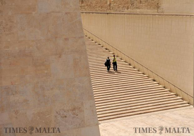 A couple walk down the city gate steps in Valletta on May 2. Photo: Chris Sant Fournier
