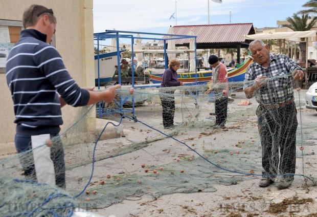 Fishermen prepare their nets at Marsaxlokk on February 29. Photo: Chris Sant Fournier