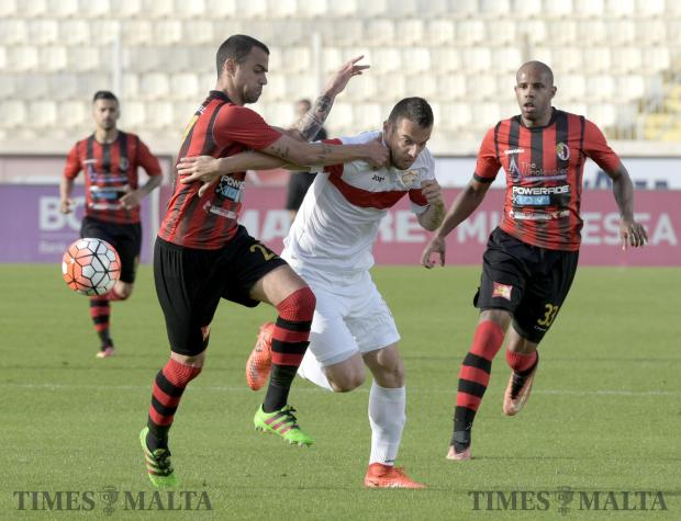 Hamrun Spartans defender, Jorginho Mesqueu (left) blocks Balzan FC forward Bojan Kaljevic from advancing forward in a match held at the National Stadium in Ta'Qali on 29 April. Photo: Mark Zammit Cordina