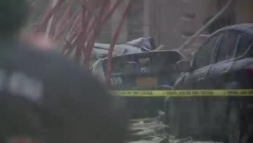 One killed as crane collapses on to parked cars in New York