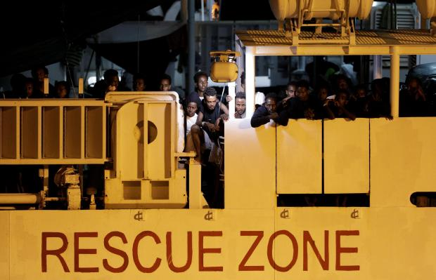 Migrants aboard a Diciotti naval vessel stuck in Catania. Photo: Reuters