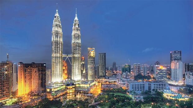 Lights illuminate skyscrapers in  Kuala Lumpur, Malaysia.
