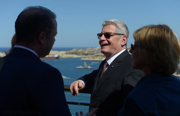 German President Joachim Gauck enjoys a moment in the sun at Upper Barrakka Gardens in Valletta, on April 30. Photo: Matthew Mirabelli