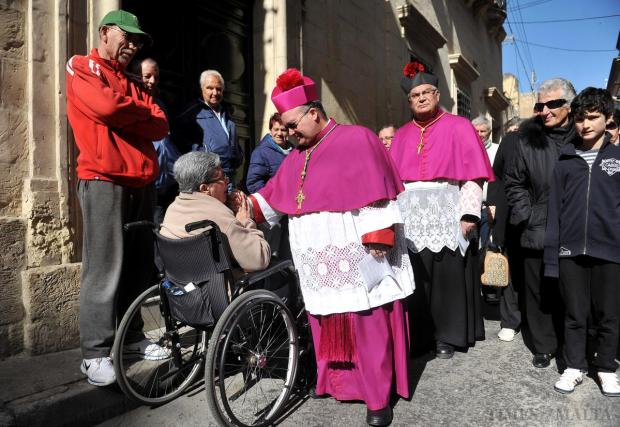 Archbishop Charles Scicluna stops and talks to a disabled person during the pilgrimage of St Gregory in Zejtun on April 8. Photo: Chris Sant Fournier