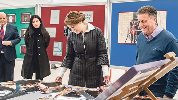 Michelle Muscat viewing students' work during her tour of the Mcast Institute of Applied Sciences.
