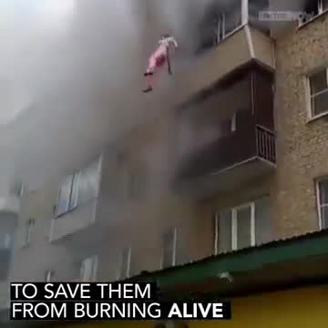 Watch: Family leaps from burning apartment and saved by crowd