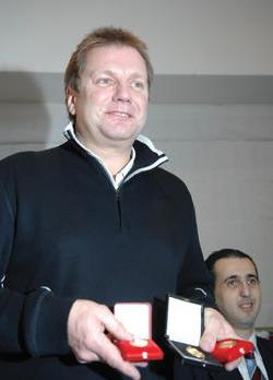 Gary Shaw shows his medals yesterday.