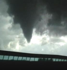 A tornado rampages through an industrial area in eastern Milan.