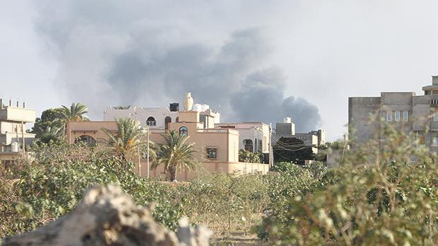 Smoke rises during heavy clashes between rival factions in Tripoli, Libya, on August 28. Photo: Hani Amara/Reuters