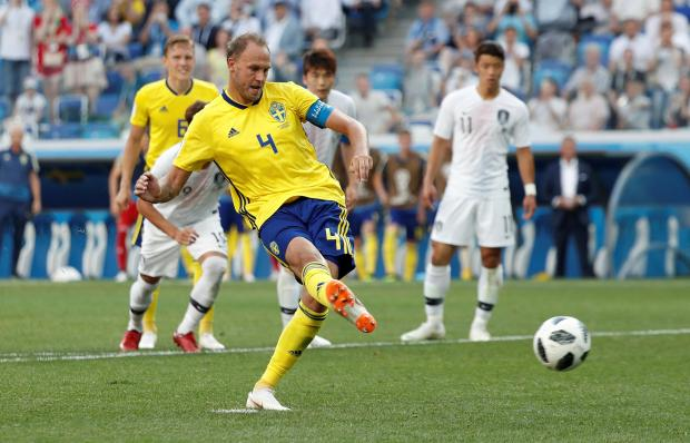 Sweden's Andreas Granqvist scores their first goal from a penalty.