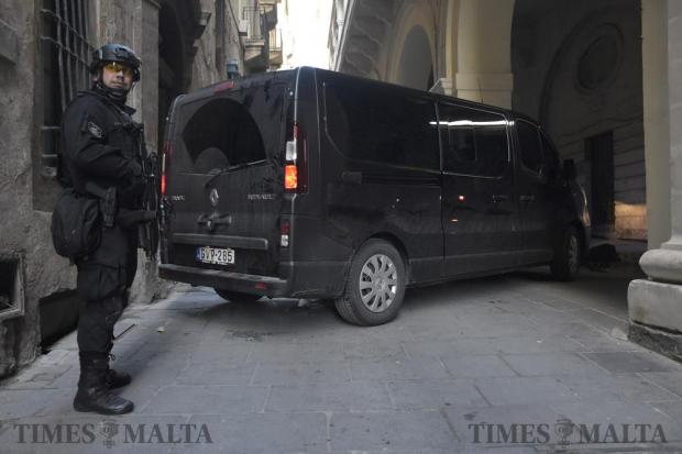 An armed police officer from the Rapid intervention Unit (RIU) guards a van whilst the two Libyan hijackers are escorted out of the Law courts in Valletta on January 4. Photo: Mark Zammit Cordina
