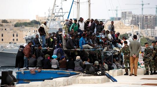 One of two boatloads of migrants fleeing the violence in Libya arriving at Haywharf in Pietà, yesterday. Photo: Darrin Zammit Lupi