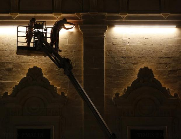 Technicians test the controversial lighting system on the facade of the Auberge de Castille in Valletta on October 26. Photo: Darrin Zammit Lupi