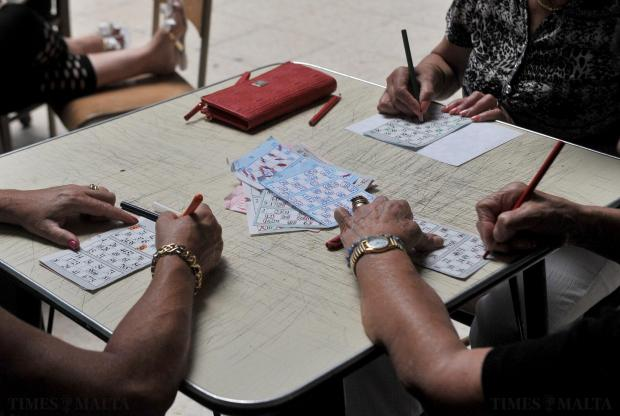 Women try their luck at bingo at the La Vallette Band Club in Valletta on June 19. Photo: Chris Sant Fournier