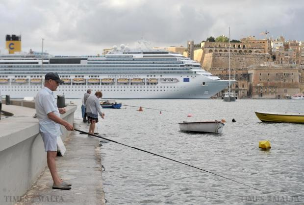 People enjoy fishing from Senglea Point in Grand Harbour on October 28. Photo: Chris Sant Fournier
