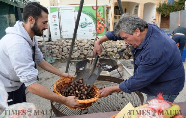 A man roasts chestnuts during the San Martin Festa in Bahrija on November 12. Photo: Matthew Mirabelli