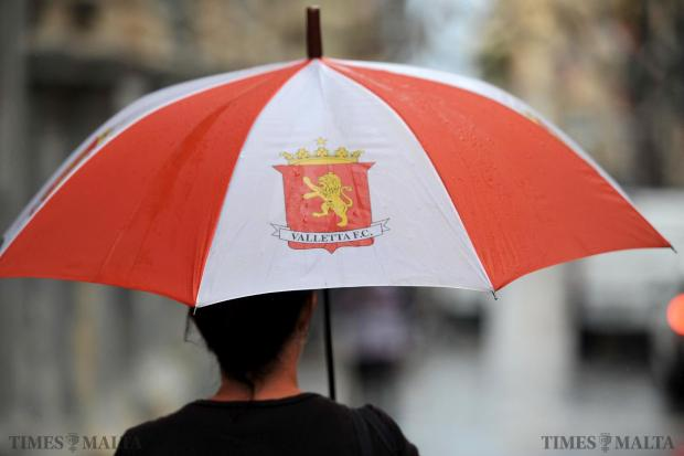 A woman shelters under an umbrella in Valletta on May 18. Photo: Chris Sant Fournier