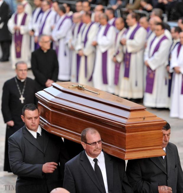 The coffin of Archbishop Emeritus Joseph Mercieca is carried down Republic Street in Valletta on March 23. Photo: Chris Sant Fournier