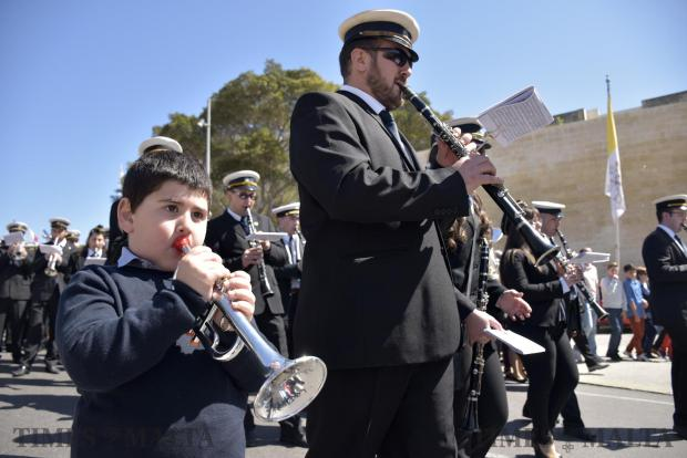 Ayoung boy joins in with a band member during the procession of the risen christ in Cospicua on March 27 Photo: Mark Zammit Cordina