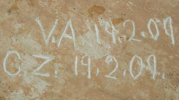 The initials and dates found engraved in the secret passages.