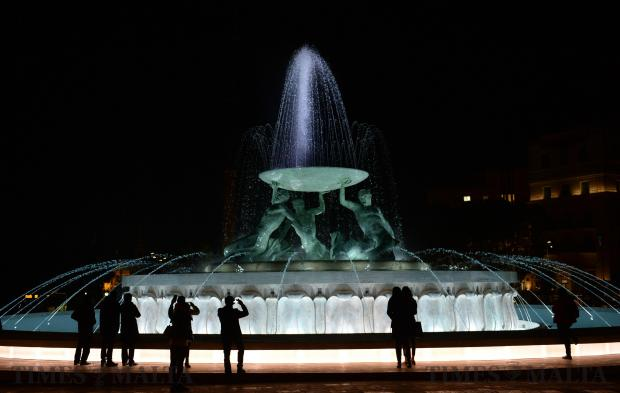 People admire the recently restored Triton Fountain at the entrance to Valletta on January 18. Photo: Matthew Mirabelli