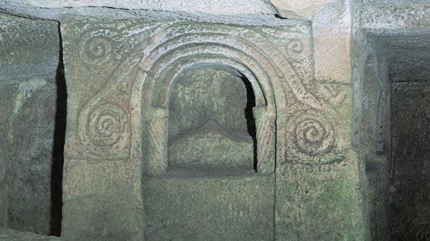 A canopied tomb at the Salina catacombs.