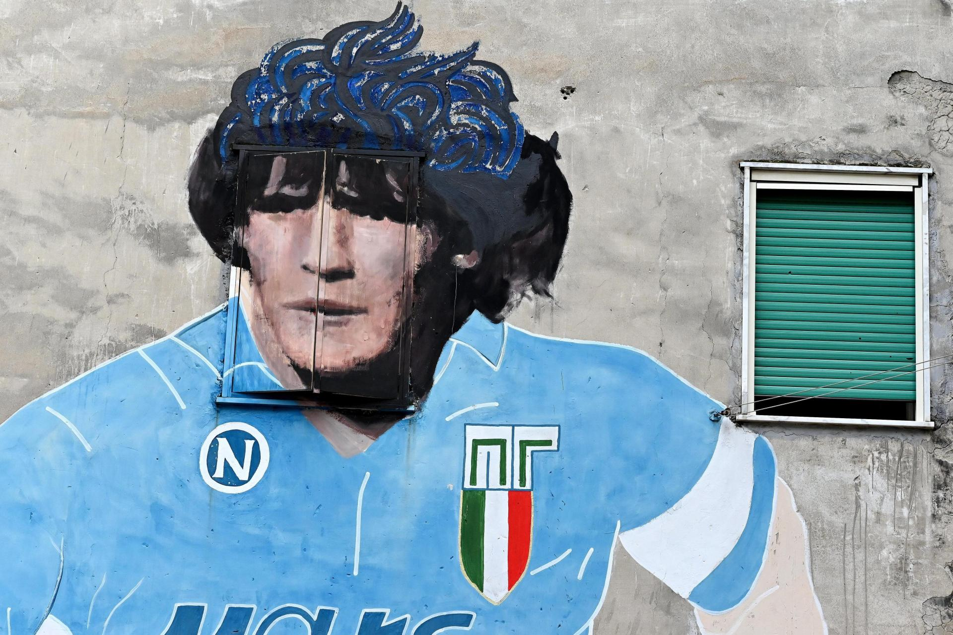 A mural of Maradona in the Italian city of Naples, where he spent his best years as a club player. Photo: AFP