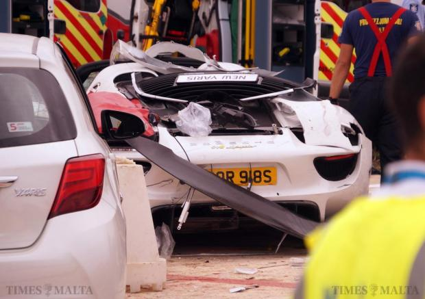 A Porsche 918 Spyder supercar is seen shortly after it crashed into bystanders during the Papqaqli ghall-Istrina charity event at Malta International Airport on October 4. 28 people were injured, some critically, in the incident. Photo: Steve Zammit Lupi